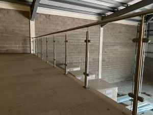 Mezzanine floor stainless steel and glass edge protection