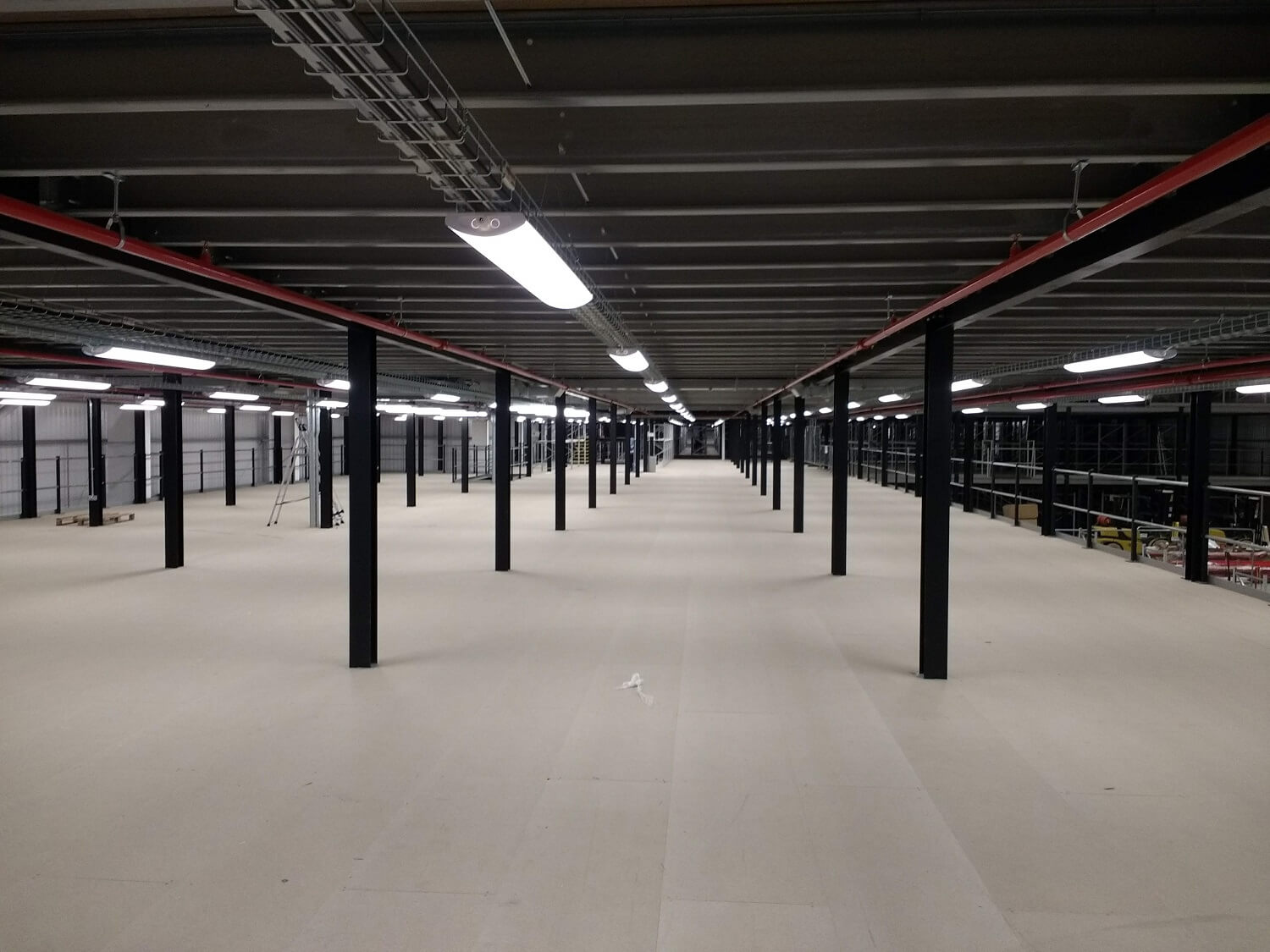 Large scale mezzanine floor view from first floor
