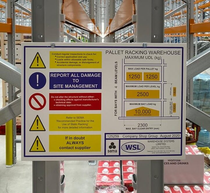 weight load notice mounted to pallet racking structure