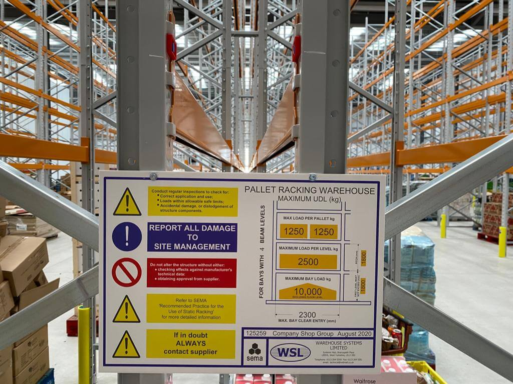 Weight load notice fixed to racking